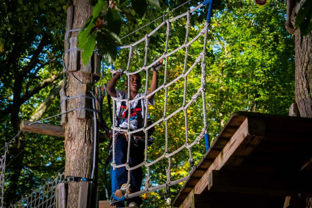 Boy Climbing On Adventure Park Challenge